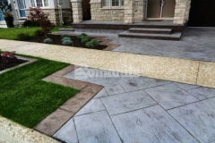 This Bomanite Yorkshire Stone imprinted concrete driveway and patio were colored using Bomanite Shale Gray Color Hardener and a Gray Release Agent to complement the coloration of the existing concrete walkway while adding unique design detail that enhances the home's architecture.