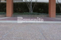 Bomanite Bomacron English Sidewalk Slate imprinted concrete with a Bomanite Sandscape Texture Exposed Aggregate finish was installed at the entrance to the Residence Condominiums to create a hardscape surface that will not show wear from traffic or need constant resealing to look fresh.