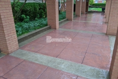 The entry sidewalk that leads to the main entrance of the Residence Condominiums was replaced with Bomanite Bomacron Slate Texture imprinted concrete, which was paired with Bomanite Cafe Au Lait Integral Color for the sidewalk bands and Bomanite Franciscan Red Color Hardener for the main expanse of the walkway to create a surface that complements the existing brick exterior colors and provides a stylish transition.