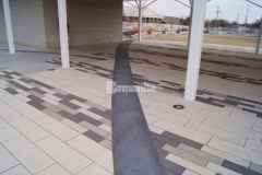 Accent borders were created in this pavilion area by installing Bomanite Sandstone imprinted concrete, which was perfect to create delineation around the concrete pavers, while enhancing the overall design aesthetic at Redbud Festival Park in Owasso, Oklahoma.