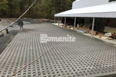 Grasscrete by Bomanite is a continuously reinforced, cast-in-place, pervious concrete that was installed at this residence to provide an extremely durable surface that will accommodate large delivery vehicles and provide stormwater management on the site.