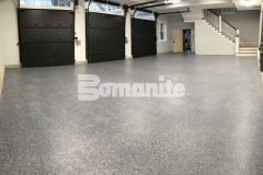 Bomanite Broadcast Flake was chosen for this space as a solution to a badly poured concrete garage foundation and this durable, protective flooring surface will stand up to long term wear and tear, including chemical resistance to gasoline, oil, and de-icing salts.