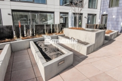 Bomanite Micro-Top ST was utilized here to create a durable concrete overlay on these tiered planter walls and this application is a low maintenance option with resistance to ultra-violet degradation from long-term exposure to sunlight, making it an economical choice for a decorative, textured surface.