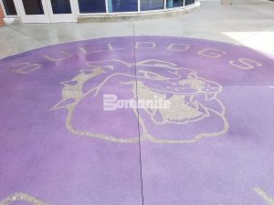 Decorative Concrete Harrisburg High School Mascot Logo using Bomanite Exposed Aggregate Systems with Bomaiite Alloy.