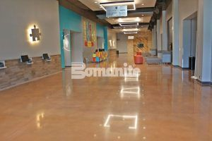 Large expanses of decorative concrete look warm and inviting with Bomanite Custom Poslingh Systems using Bomanite Patene Teres decorative concrete installed by Texas Bomanite at Hope Fellowship Bible Church.