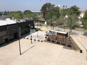 """Concrete Bands pointing to the Banc of Calif LAFC stadium are Bomanite Imprint 11.5"""" Boardwalk Gray Bands with Bomanite Sandscape Texture Walkway."""