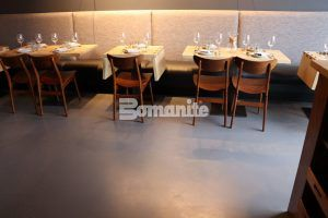 A view of drop leaf tables and the sophisticated decorative concrete flooring of Bomanite Toppings Systems using Bomanite Micro Top at Elmwood in Maplewood, MO, installed by Musselman and Hall.