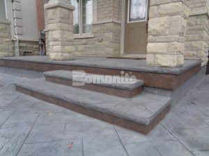 Angled view of the steps and porch featuring Bomanite Imprint Systems decorative concrete using Yorkshire Stone Pattern with Bomanite Shale Gray Color Hardener installed at a residence in Burlington, Ontario, by Bomanite Toronto located in Vaughn, Ontario near Toronto Canada.
