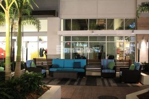 Seating with store fronts in the background with Bomanite Imprint Systems Bomacron Boardwalk Pattern Used in Lounge Area at the Tanger Outlets in Daytona, FL, installed by Bomanite Licensee Edwards Concrete located in Winter Gardens, FL.