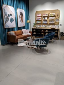 Long view of the sample corner at the flagship store of Nickel & Suede with Bomanite Modena SL Custom Polished decorative concrete overlay installed by Musselman & Hall Contractors, LLC in Kansas City, MO.
