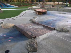 Long view of the bridge and splash pad area at Downtown Bellevue Park in WA, featuring Bomanite Imprint Systems decorative concrete installed by Belarde Company.