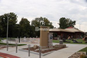 Entrance to the Community Park in Jefferson City, MO, which features a fun splash pad using Bomanite Sandscape Texture Exposed Aggregate System with Bomanite Con-Color installed by Bomanite Licensee Musselman & Hall Contractors, LLC.