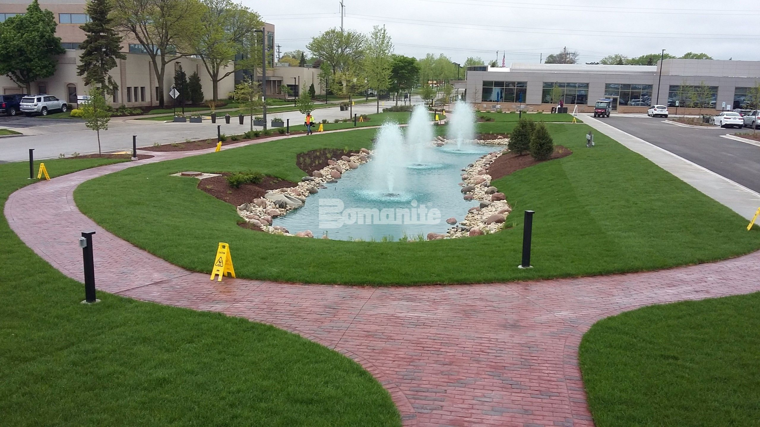 Bomanite of Wisconsin uses Bomanite Imprint Systems to create 6,000 SF of paved concrete pathways leading up to various buildings and surrounding the featured fountains in the center of Direct Supply headquarters in Milwaukee, WI.